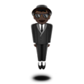 Man in Suit Levitating: Dark Skin Tone on Apple iOS 12.1
