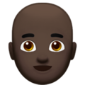 Man: Dark Skin Tone, Bald on Apple iOS 12.2