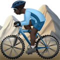 Person Mountain Biking: Dark Skin Tone on Apple iOS 12.2