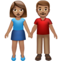 Woman and Man Holding Hands: Medium Skin Tone on Apple iOS 13.3
