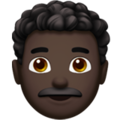 Man: Dark Skin Tone, Curly Hair on Apple iOS 13.3