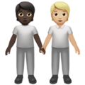 People Holding Hands: Dark Skin Tone, Medium-Light Skin Tone on Apple iOS 14.2