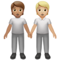 People Holding Hands: Medium Skin Tone, Medium-Light Skin Tone on Apple iOS 14.2
