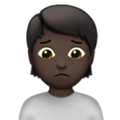 Person Frowning: Dark Skin Tone on Apple iOS 14.2