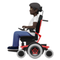 Person in Motorized Wheelchair: Dark Skin Tone on Apple iOS 14.2