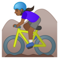 Woman Mountain Biking: Medium-Dark Skin Tone on Google Android 10.0 March 2020 Feature Drop