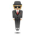 Person in Suit Levitating: Medium-Light Skin Tone on Google Android 11.0 December 2020 Feature Drop