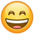 Grinning Face with Smiling Eyes on WhatsApp 2.19.352