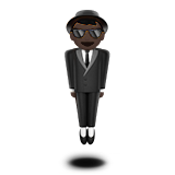 Person in Suit Levitating: Dark Skin Tone on Apple iOS 11.2