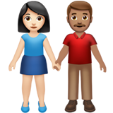Woman and Man Holding Hands: Light Skin Tone, Medium Skin Tone on Apple iOS 13.2