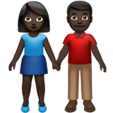 Woman and Man Holding Hands: Dark Skin Tone on Apple iOS 14.2