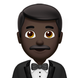Man in Tuxedo: Dark Skin Tone on Apple iOS 10.2