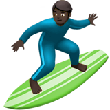 Man Surfing: Dark Skin Tone on Apple iOS 10.2