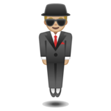 Person in Suit Levitating: Medium-Light Skin Tone on Google Android 10.0 March 2020 Feature Drop