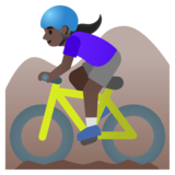 Woman Mountain Biking: Dark Skin Tone on Google Android 11.0