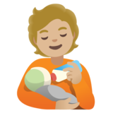 Person Feeding Baby: Medium-Light Skin Tone on Google Android 11.0 December 2020 Feature Drop