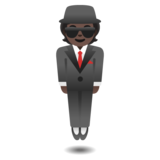Person in Suit Levitating: Dark Skin Tone on Google Android 11.0 December 2020 Feature Drop