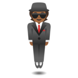 Person in Suit Levitating: Medium-Dark Skin Tone on Google Android 11.0 December 2020 Feature Drop