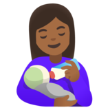 Woman Feeding Baby: Medium-Dark Skin Tone on Google Android 11.0 December 2020 Feature Drop