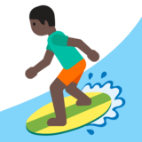 Person Surfing: Dark Skin Tone on Google Android 7.1