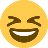 Grinning Squinting Face on Twitter Twemoji 2.4