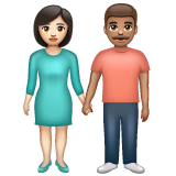 Woman and Man Holding Hands: Light Skin Tone, Medium Skin Tone on WhatsApp 2.19.352